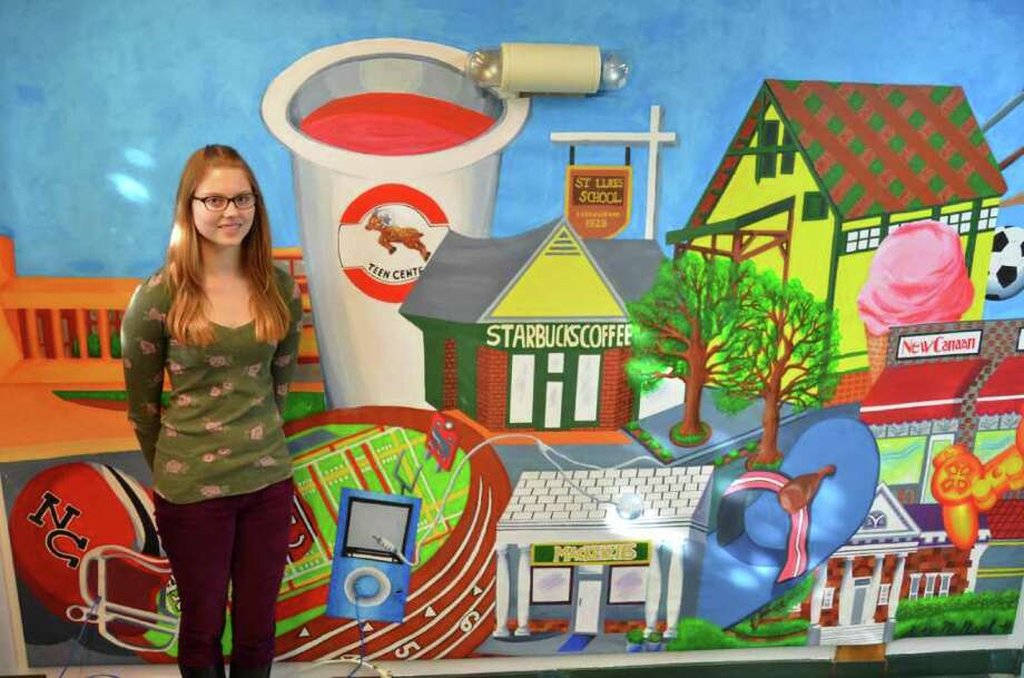 Katie Melland stands next to her mural of teens' favorite things and places in New Canaan. Photo: Contributed Photo