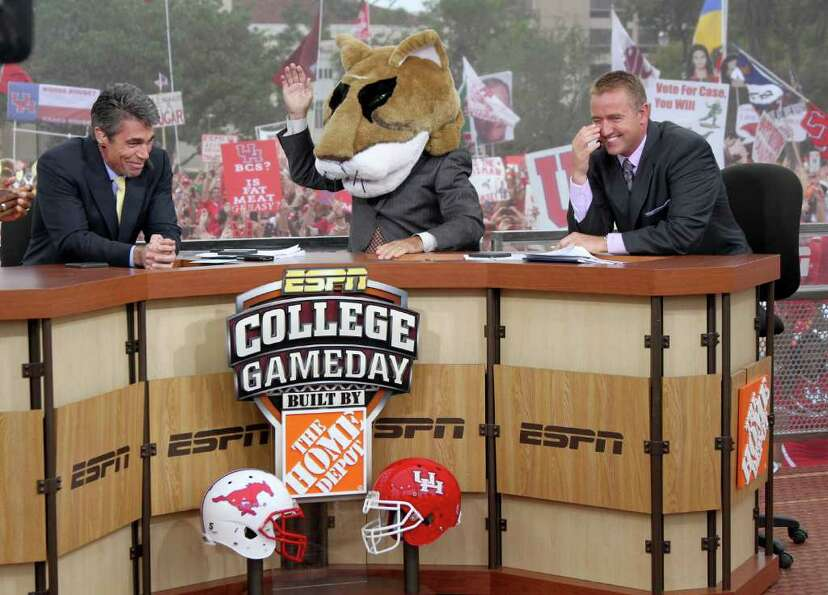 11/19/11:  ESPN commentators Chris Fowler, Lee Corso and Kirk Herbstreit laugh as Corso pouts on the