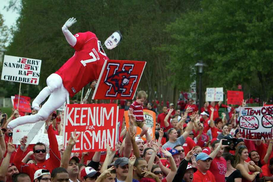 UH fans cheer on the ESPN College GameDay set at Cullen Circle on the University of Houston campus, Friday, Nov. 18, 2011, in Houston. The national broadcast originated from UH before the 11th ranked Cougars' game against SMU. Photo: Smiley N. Pool, Houston Chronicle / © 2011  Houston Chronicle