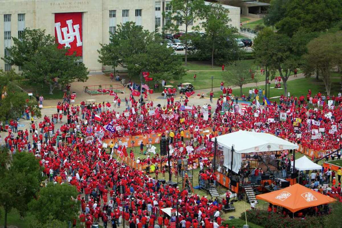 A crowd of UH fans gathers around on the ESPN College GameDay set at Cullen Circle on the University of Houston campus, Friday, Nov. 18, 2011, in Houston. The national broadcast originated from UH before the 11th ranked Cougars' game against SMU.