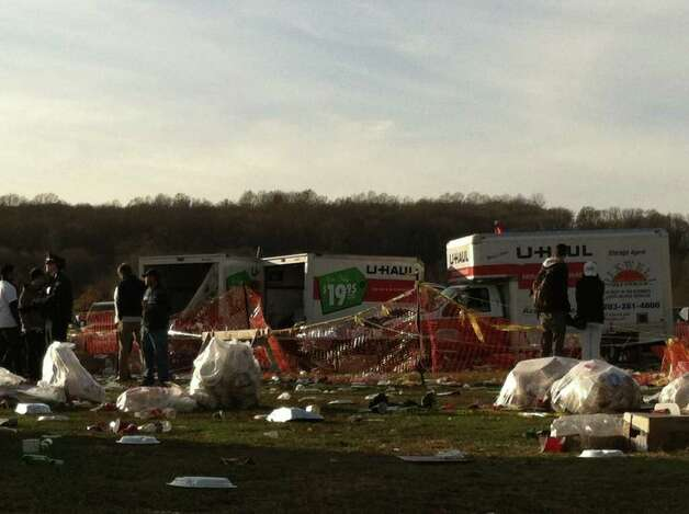 A driver of a U-Haul truck carrying beer kegs through a tailgating area before the Yale-Harvard game Saturday suddenly accelerated, fatally striking a 30-year-old Massachusetts woman and injuring two other women, police said. Photo: Sean Bowley / Connecticut Post