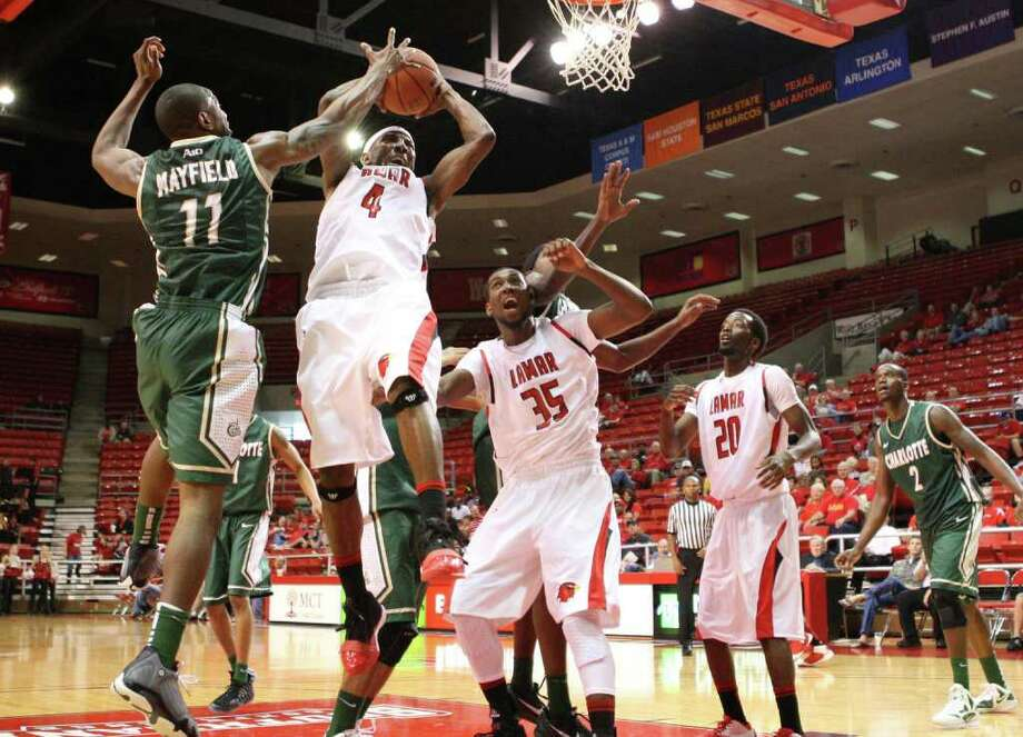Lamar's Devon Lamb grabs a rebound during Lamar's 72-54 win over Charlotte on Saturday at the Montagne Center. Photo: Matt Billiot