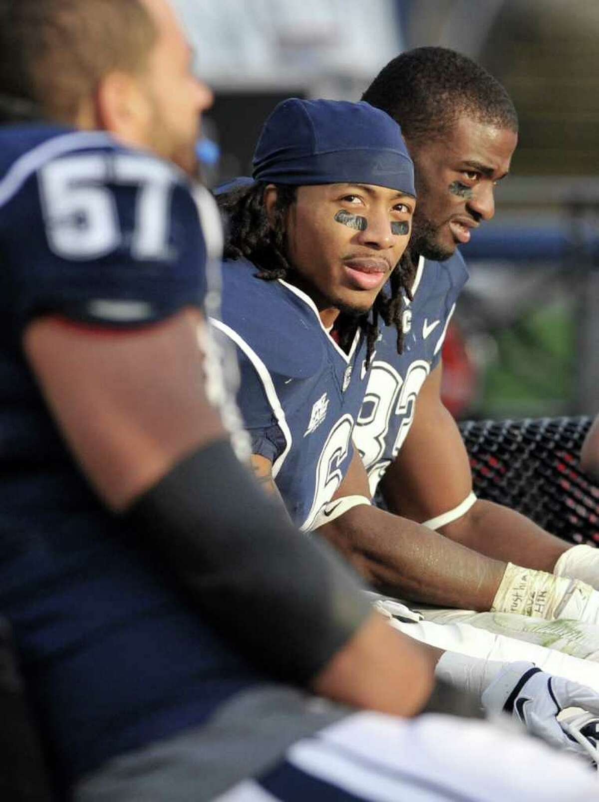 Connecticut's Kashif Moore, center, looks toward the scoreboard in the fourth quarter of an NCAA college football game at Rentschler Field in East Hartford, Conn., Saturday, Nov. 19, 2011. Louisville beat Connecticut 34-20. (AP Photo/Jessica Hill)