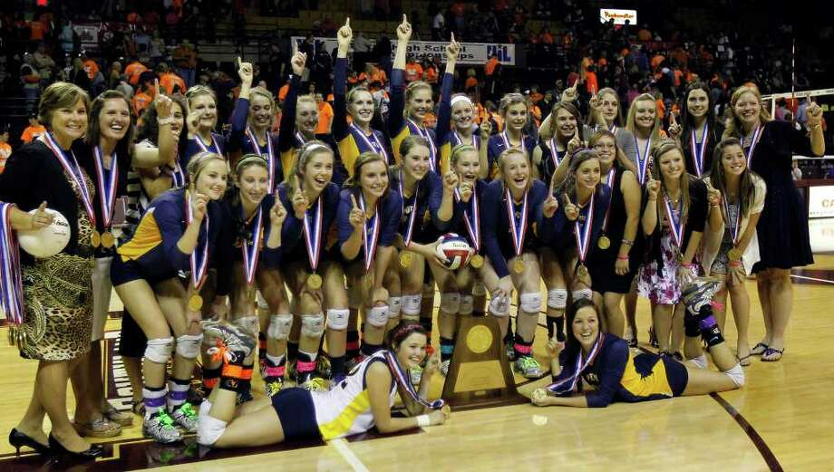 FOR SPORTS - The Poth team poses for a portrait after defeating Nocona to win the class 2A state volleyball final at Strahan Coliseum at Texas State University on Saturday, Nov. 19, 2011. MICHAEL MILLER / mmiller@express-news.net Photo: MICHAEL MILLER, SAN ANTONIO EXPRESS-NEWS / mmiller@express-news.net