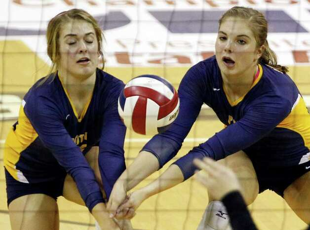 FOR SPORTS - Poth's Corin Nelson, left, and Jordan Kotara work for a dig during game action of the class 2A state volleyball final against Nocona at Strahan Coliseum at Texas State University on Saturday, Nov. 19, 2011. MICHAEL MILLER / mmiller@express-news.net Photo: MICHAEL MILLER, SAN ANTONIO EXPRESS-NEWS / mmiller@express-news.net