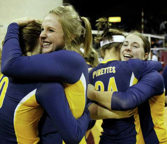 FOR SPORTS - Poth's Avery Acker, left, and Claire Raabe, left center, hug while Micah Weaver, right center, and Jessica Dziuk, right, hug after defeating Nocona in the class 2A state volleyball final at Strahan Coliseum at Texas State University on Saturday, Nov. 19, 2011. MICHAEL MILLER / mmiller@express-news.net Photo: MICHAEL MILLER, SAN ANTONIO EXPRESS-NEWS / mmiller@express-news.net