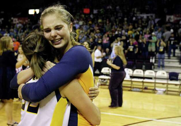 FOR SPORTS - Poth's Morgan Koenig, left and Jordan Kotara hug after defeating Nocona in the class 2A state volleyball final at Strahan Coliseum at Texas State University on Saturday, Nov. 19, 2011. Poth won in straight sets. MICHAEL MILLER / mmiller@express-news.net Photo: MICHAEL MILLER, SAN ANTONIO EXPRESS-NEWS / mmiller@express-news.net