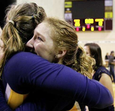 FOR SPORTS - Poth's Avery Acker, right, cries while hugging Jordan Kotara after defeating Nocona in the class 2A state volleyball final at Strahan Coliseum at Texas State University on Saturday, Nov. 19, 2011. MICHAEL MILLER / mmiller@express-news.net Photo: MICHAEL MILLER, SAN ANTONIO EXPRESS-NEWS / mmiller@express-news.net