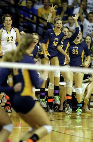 FOR SPORTS - Poth celebrates after winning a point during game action of the class 2A state volleyball final against Nocona at Strahan Coliseum at Texas State University on Saturday, Nov. 19, 2011. Poth won in straight sets. MICHAEL MILLER / mmiller@express-news.net Photo: MICHAEL MILLER, SAN ANTONIO EXPRESS-NEWS / mmiller@express-news.net