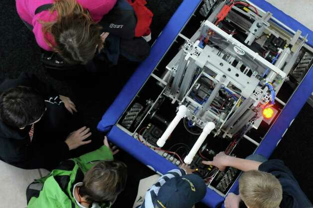 Ballsaton Spa High School shows off the inner workings of their robot during the ?Capital Region Nanotechnology Showcase?  at CNSE?s Albany NanoTech Complex in Albany, NY Saturday, Nov.19, 2011.( Michael P. Farrell/Times Union) Photo: Michael P. Farrell