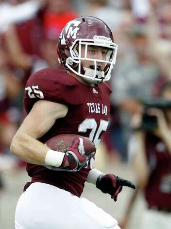 CORRECTS TO KANSAS, NOT KANSAS STATE - Texas A&M wide receiver Ryan Swope (25) runs into the end zone for a touchdown during the first half of an NCAA college football game against Kansas on Saturday, Nov. 19, 2011, in College Station, Texas. (AP Photo/Houston Chronicle, Karen Warren) MANDATORY CREDIT Photo: AP