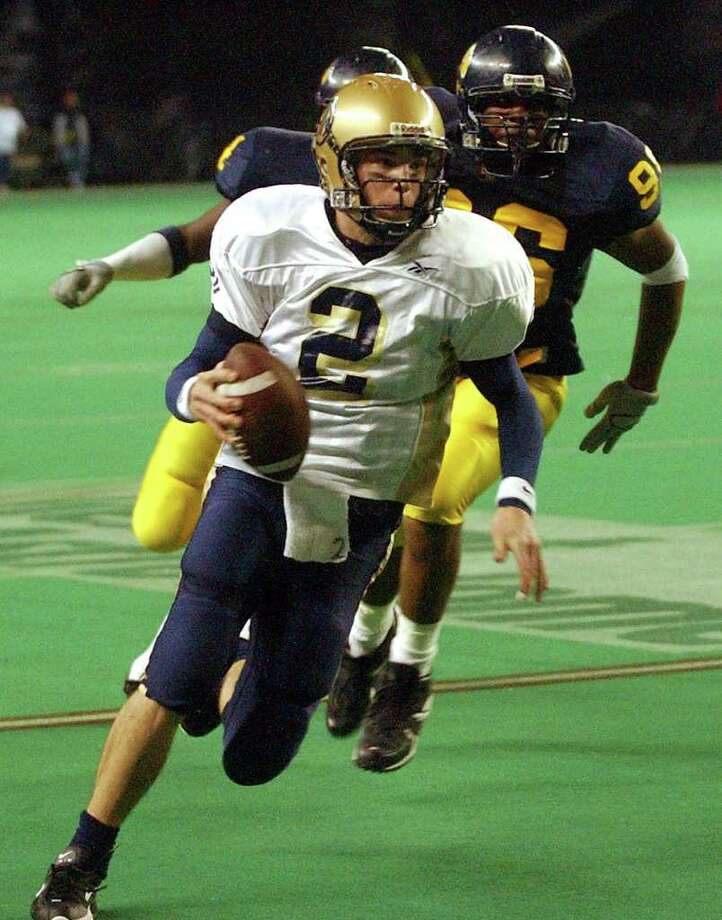 Chase Clement rolls to the one yard line in the first half at the Astrodome against La Marque, Dec. 12, 2003. Photo: TOM REEL, SAN ANTONIO EXPRESS-NEWS / SAN ANTONIO EXPRESS-NEWS