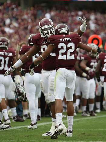 Texas A&M Aggies defensive back Dustin Harris (22) celebrates his touchdown run with Texas A&M Aggies defensive lineman Tony Jerod-Eddie (83) during the fourth quarter of the college football game at Texas A&M, Nov. 19, 2011. Texas A&M beat Kansas 61-7. Photo: Karen Warren, Houston Chronicle / © 2011 Houston Chronicle