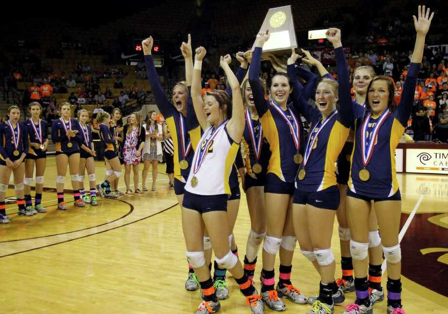 Poth players celebrate after defeating Nocona to win the class 2A state volleyball final at Strahan Coliseum at Texas State University on Saturday, Nov. 19, 2011. MICHAEL MILLER / mmiller@express-news.net Photo: MICHAEL MILLER, Express-News / mmiller@express-news.net