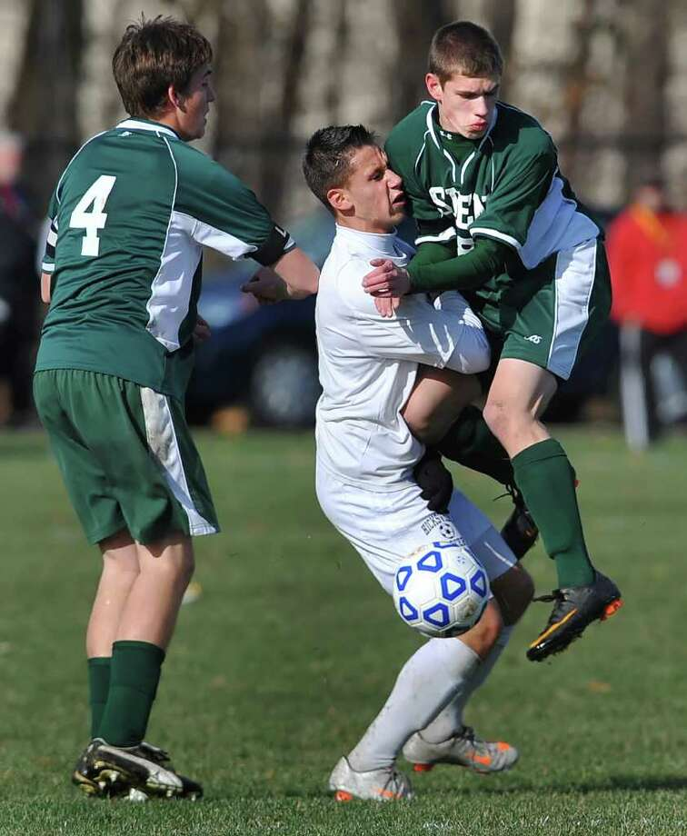 Shenendehowa's Ricky Grable, right, collides over the ball with Hicksville's Robert Aranov during Class AA NYSPHSAA Boys Soccer Championship semifinal played on Saturday, November 19, 2011 at Middletown High School.  Hicksville (Section 8) beat Shenendehowa (section 2) 3-0 to advance to Sunday's state championship game.  (Adrian Kraus / Special to the Times Union) Photo: Adrian Kraus / © akoPhoto 2011