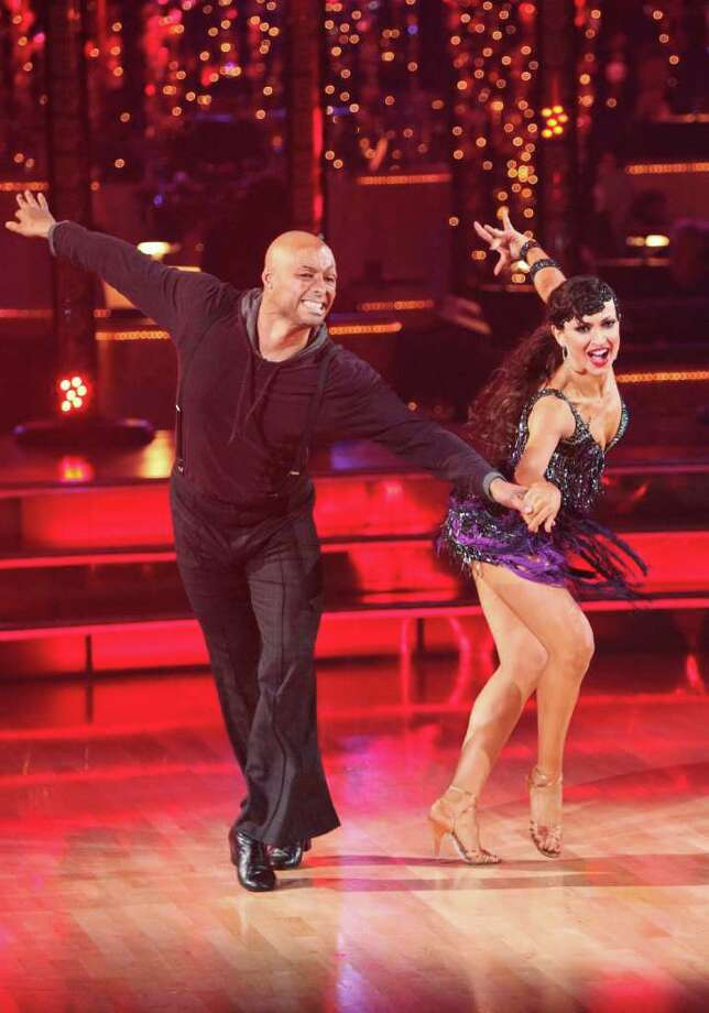 "In this Nov. 14, 2011 image released by ABC, war veteran J.R. Martinez, left, and his partner Karina Smirnoff perform on the celebrity dance competition series ""Dancing with the Stars,"" in Los Angeles. Photo: AP"