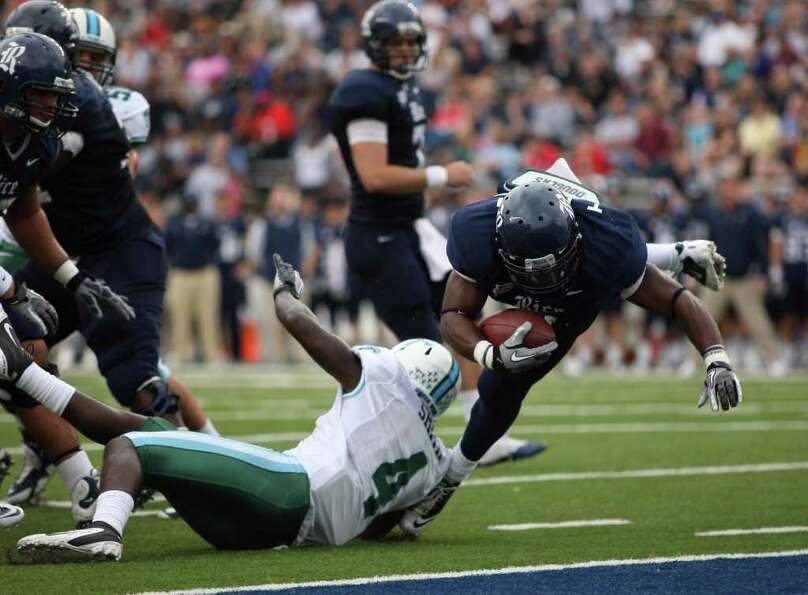 Rice's Tyler Smith (right)  jumps over Tulane's Shakiel Smith into the end zone for a touchdown duri