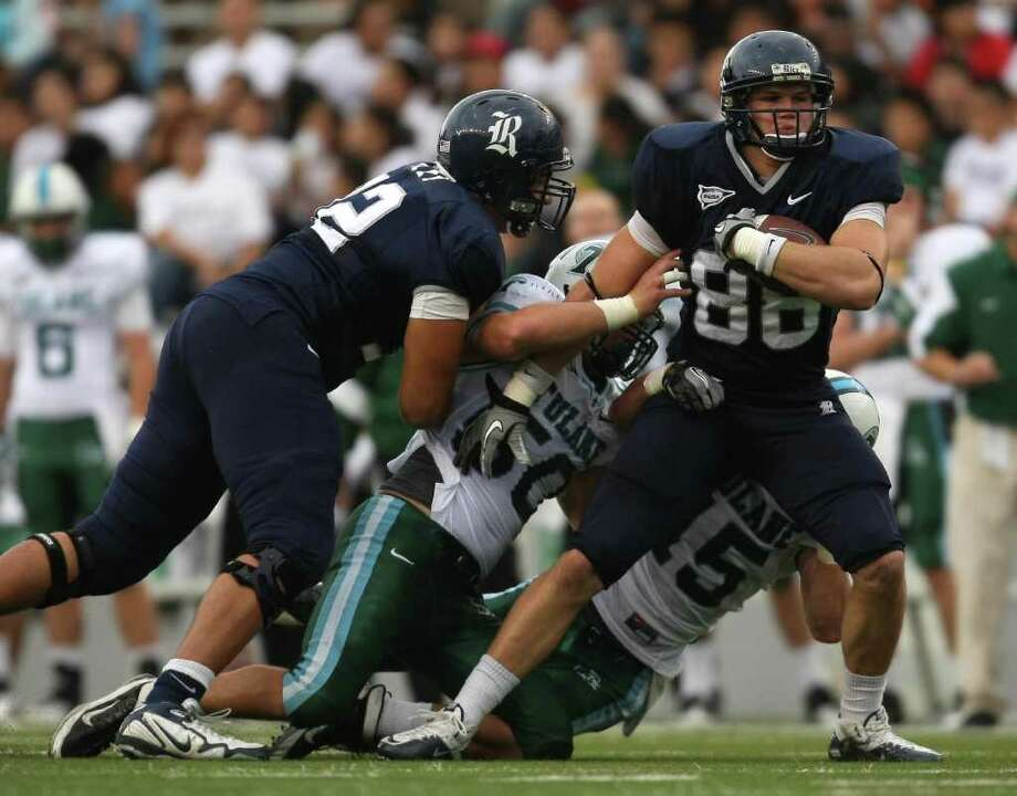 Rice's Vance McDonald carries Tulane's Austen jacks (50) and Tayler Echols during the first half of a Conference USA football game, Saturday, November 19, 2011 at Rice Stadium in Houston, TX. Photo: Eric Christian Smith, For The Chronicle