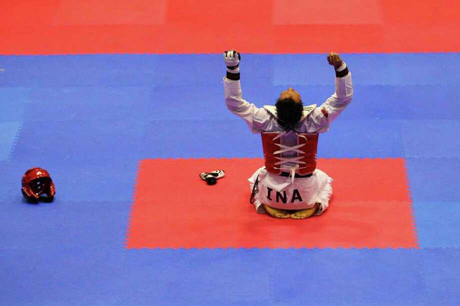 Nugroho Basuki of Indonesia celebrates winning his fight against Anthony Soriano Jose of the Philippines during the final of the under 87 male taekwondo on day four of the 2011 Southeast Asian Games at Popki Cibubur on November 14, 2011 in Jakarta, Indonesia. Photo: Cameron Spencer, Getty / 2011 Getty Images
