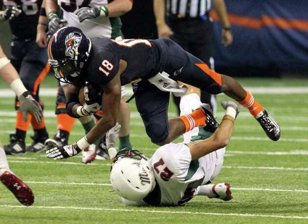 UTSA's Kenny Harrison trips over Minot's John Denne (27) in the first half at the Alamodome on Saturday, Nov. 19, 2011. Kin Man Hui/kmhui@express-news.net Photo: Kin Man Hui, ~ / San Antonio Express-News