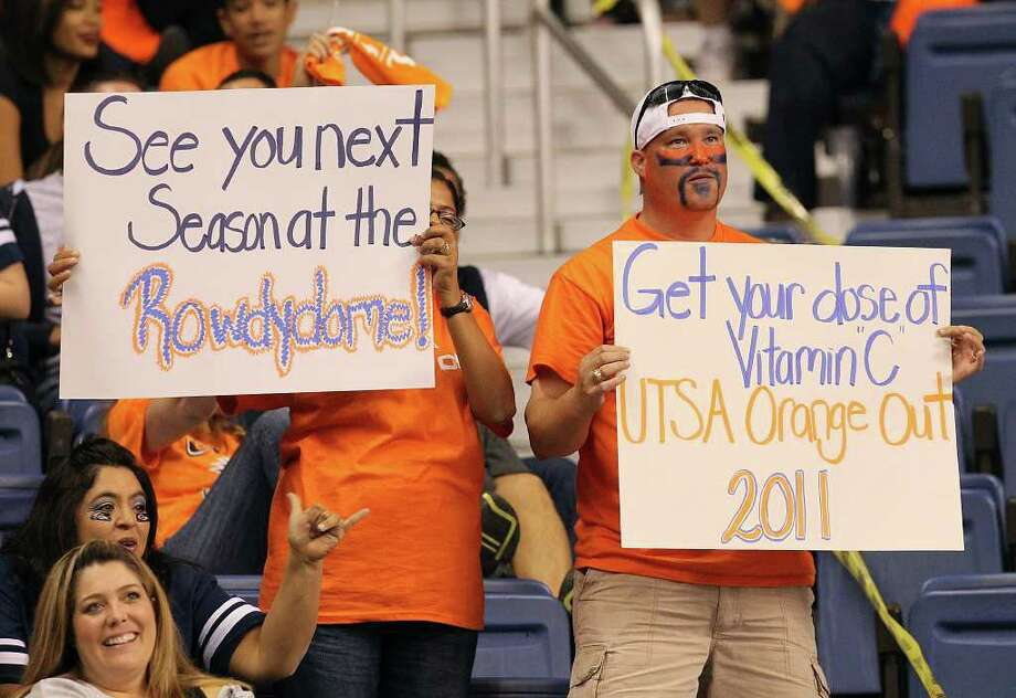 Two UTSA football fans express their support in signs during the game against Minot at the Alamodome on Saturday, Nov. 19, 2011. UTSA defeated Minot 49-7 for a victory to end their inaugural season. Kin Man Hui/kmhui@express-news.net Photo: Kin Man Hui, ~ / San Antonio Express-News