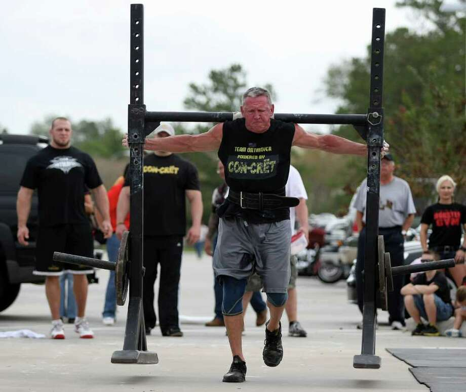 Roger Oatmayer, 65, competes in the 60+ light-weight division of the Texas Strongest Man competition, Saturday, November 19, 2011 at Harley Davidson-Kingwood, in Kingwood. Photo: Eric Christian Smith, For The Chronicle