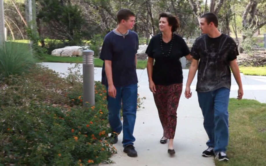 "In this scene from ""Coping to Excelling,"" Jennifer Allen is seen with her sons Sam (left) and Charlie. Jennifer Allen made the documentary after Sam's form of high-functioning autism, called Asperger's syndrome, was diagnosed. Photo: COURTESY JENNIFER ALLEN"