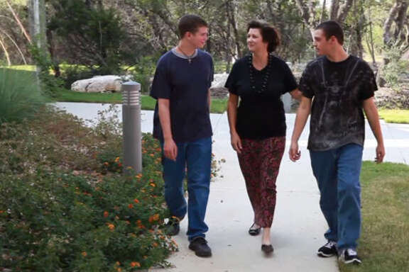 """IN THIS SCENE FROM """"COPING TO EXCELLING,' JENNIFER ALLEN IS SEEN WITH HER SONS SAM (LEFT) AND CHARLIE. SAM HAS BEEN DIAGNOSED WITH A FORM OF HIGH-FUNCTIONING AUTISM CALLLED ASPERGER'S SYNDROME."""