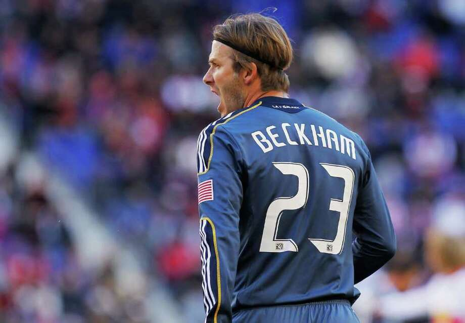 MIND-BENDER: David Beckham makes more this season than the Dynamo roster, but the Galaxy no doubt will consider him worth every penny if L.A. wins the MLS Cup tonight. Photo: Mike Stobe / 2011 Getty Images
