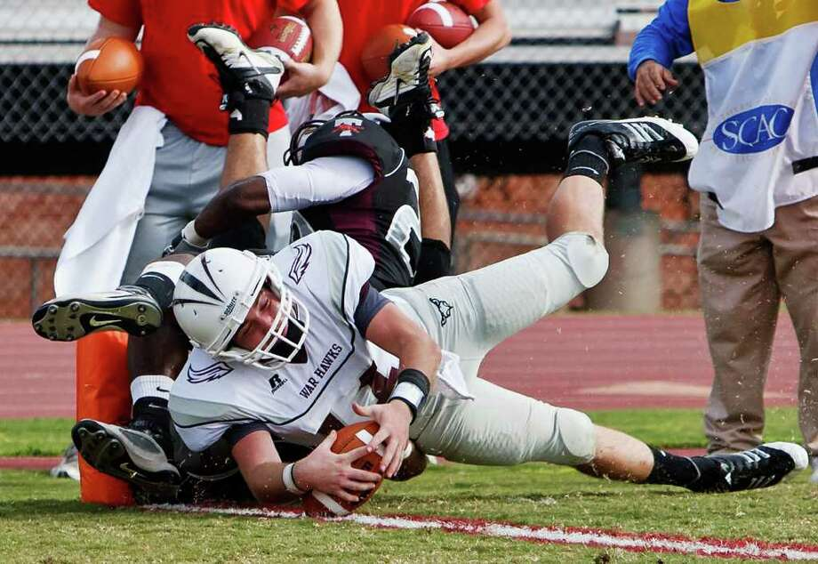 McMurray quarterback Stephen Warren crosses the goal line for a two-point conversion during the third quarter of their NCAA Division III first-round playoff game at Trinity University Stadium on Nov. 19, 2011. Photo: MARVIN PFEIFFER, Express-News / Express-News 2011
