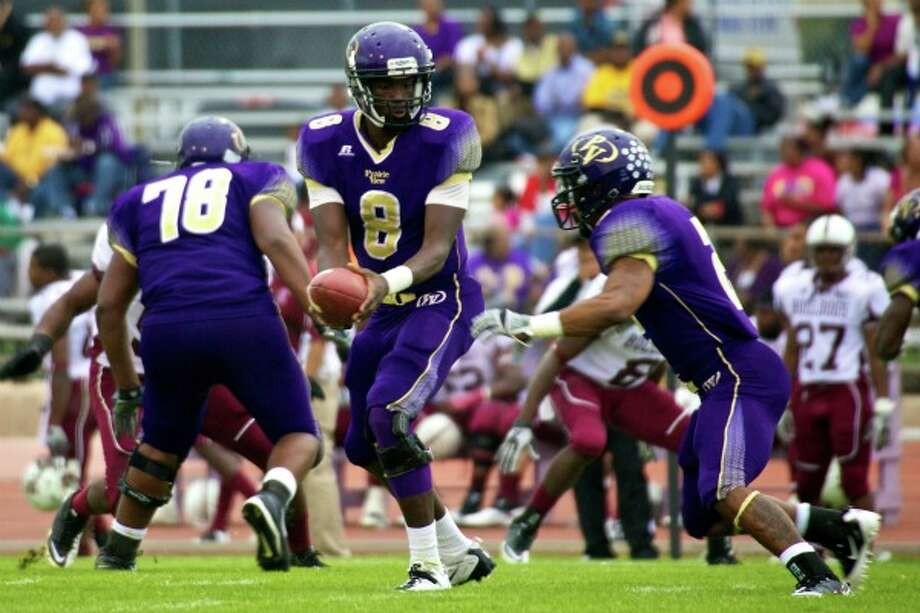 Prairie View A&M quarterback Jerry Lovelocke (8) hands the ball off to running back Fred Anderson during Saturday's game against Alabama A&M. Anderson rushed for 119 yards. (Robert Houston Photography)