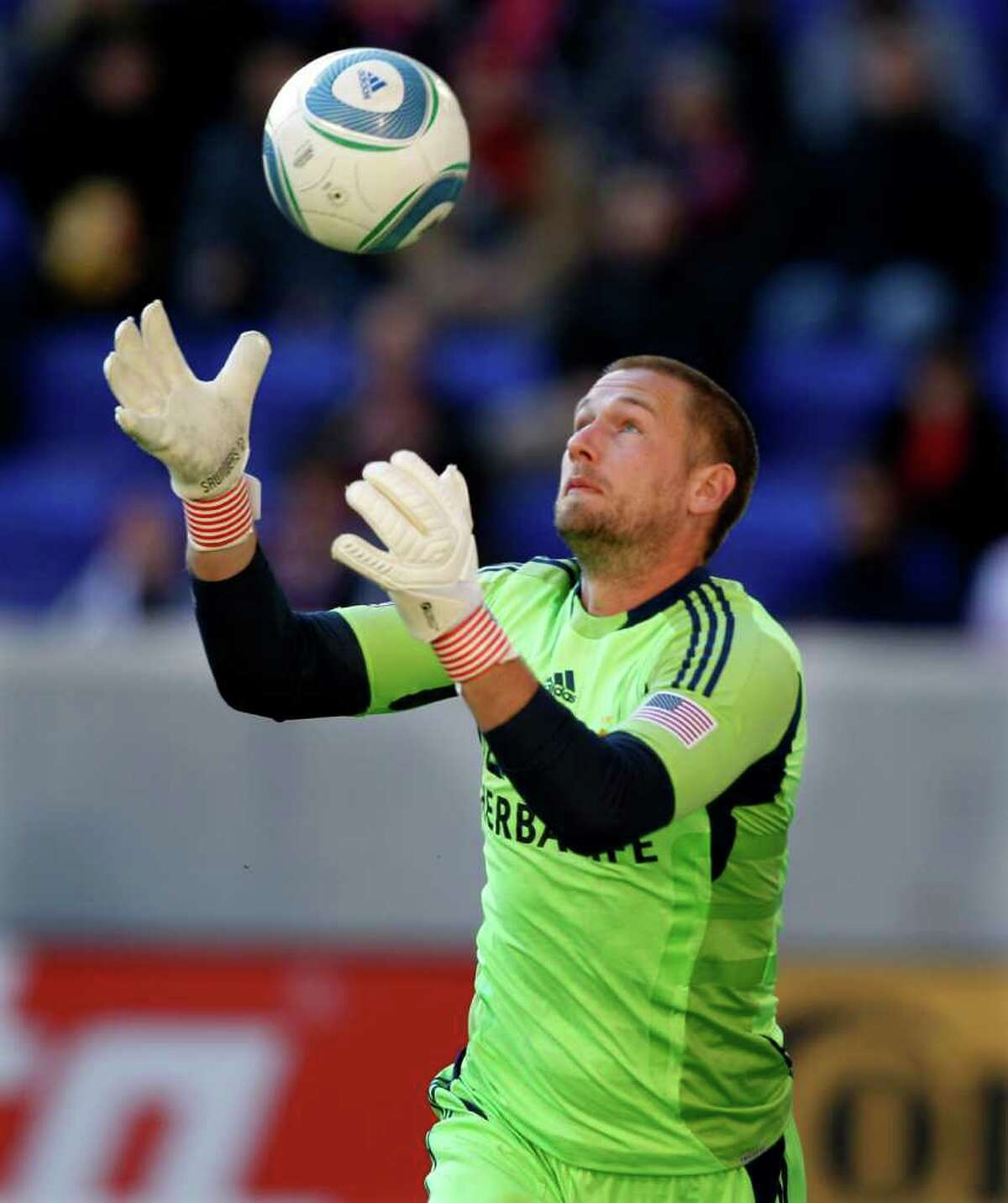 Los Angeles Galaxy goalkeeper Josh Saunders makes a save during the first period of an MLS soccer match against the New York Red Bulls Sunday, Oct. 30, 2011, Newark, N.J. (AP Photo/Mel Evans)
