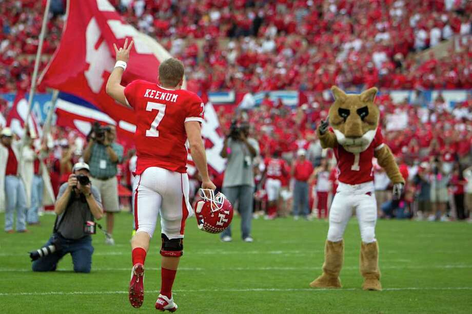 Houston quarterback Case Keenum (7)  runs onto the field as he is introduced during a senior day recognition before facing SMU in an NCAA football game at Robertson Stadium, Saturday, Nov. 19, 2011, in Houston. Photo: Smiley N. Pool, Houston Chronicle / © 2011  Houston Chronicle