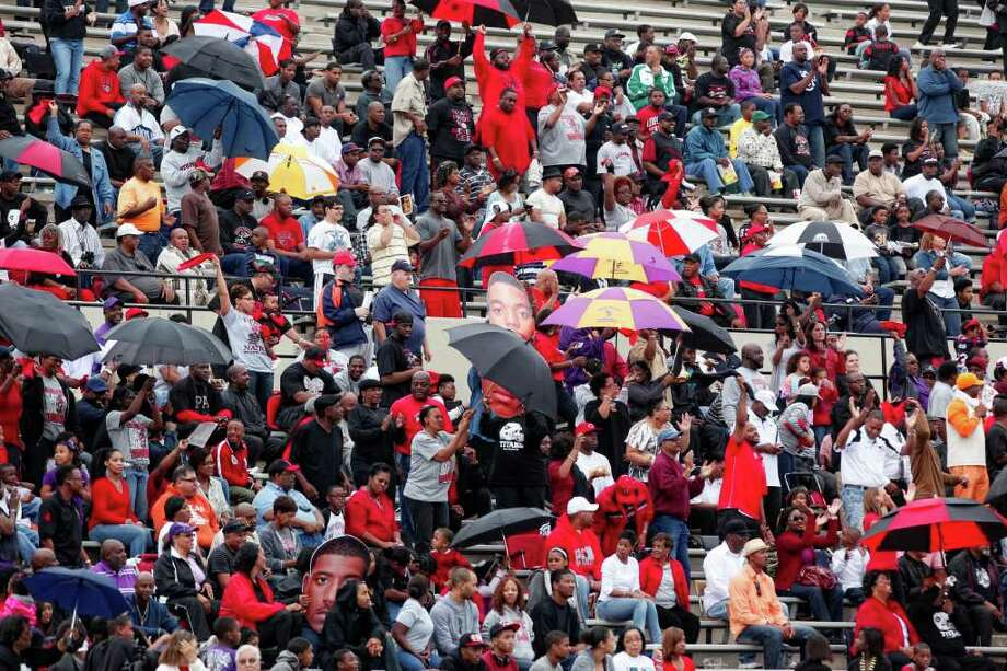 Memorial fans dance with their umbrellas following a Memorial touchdown, during the second half of a high school football playoff game between the Clear Springs High School Chargers and the Port Arthur Memorial Titans, Saturday, November 19, 2011 at Stallworth Stadium in Baytown, Texas. PA Memorial won 38-35. Photo: TODD SPOTH, For The Chronicle / Todd Spoth