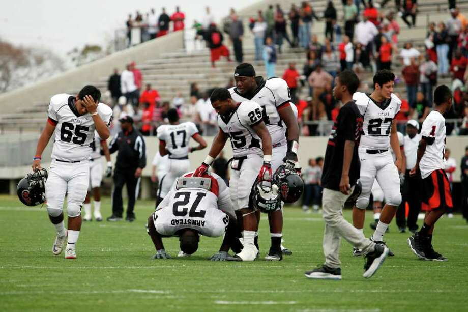 Memorial players including offensive lineman, Tre'Von Armstead, 72, are visibly shaken, following a high school football playoff game between the Clear Springs High School Chargers and the Port Arthur Memorial Titans, Saturday, November 19, 2011 at Stallworth Stadium in Baytown, Texas. PA Memorial won 38-35. Two Memorial players suffered injuries which included heat exhaustion and had to be taken off the field by EMT's. Photo: TODD SPOTH, For The Chronicle / Todd Spoth