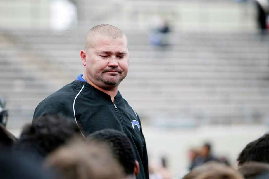 Clear Springs head coach, Clint Hartman, addresses his team following a high school football playoff game between the Clear Springs High School Chargers and the Port Arthur Memorial Titans, Saturday, November 19, 2011 at Stallworth Stadium in Baytown, Texas. PA Memorial won 38-35. Photo: TODD SPOTH, For The Chronicle / Todd Spoth