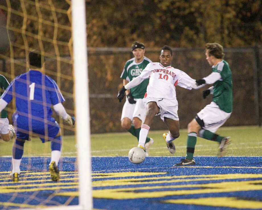 Pomperaug's Scott Grant gets off a shot against Guilford during the Panthers'  Class LL state tournament semifinal game Saturday at Municipal Stadium in Waterbury. Photo: Barry Horn