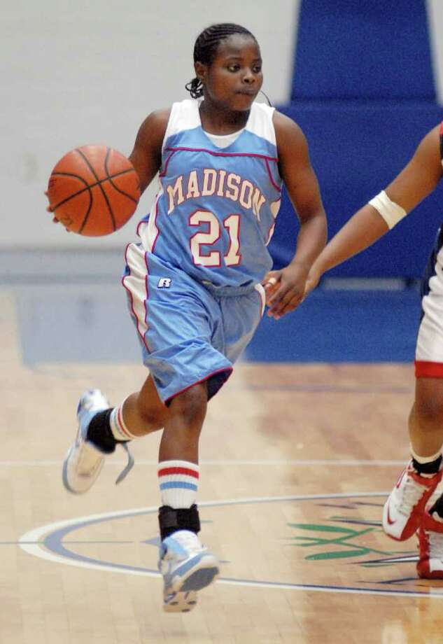 Madison's Porsche Landry brings the ball up the court against Lamar at Delmar Fieldhouse Wednesday Jan. 02,2008..(Dave Rossman/For the Chronicle) Photo: Dave Rossman / freelance