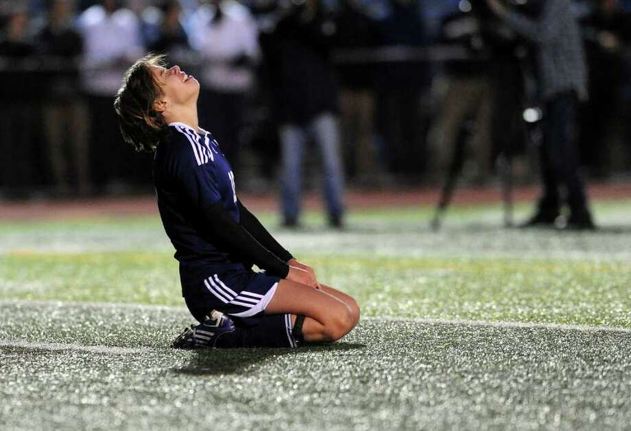 Staples' #16 Megan Root reacts after missing a goal kick against Glastonbury in an overtime shootout, during CIAC Girls Soccer State Tournament Class LL Semifinal action in West Haven, Conn. on Saturday November 19, 2011. Photo: Christian Abraham / Connecticut Post