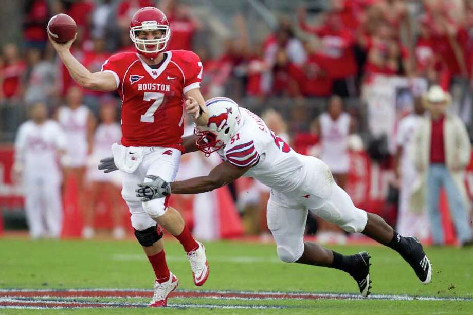 Houston quarterback Case Keenum (7) gets off a pass as he is hit by SMU defensive lineman Stephon Sanders (51) during the first quarter. Photo: Smiley N. Pool, Houston Chronicle / © 2011  Houston Chronicle