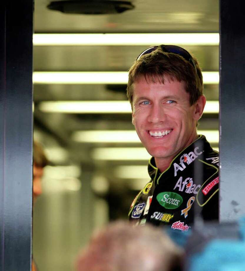 Carl Edwards, driver of the No.99 Aflac Ford, looks out his trailer at the Homestead-Miami Speedway in Homestead, Florida, Friday, November 18, 2011. (Peter Andrew Bosch/Miami Herald/MCT) Photo: Peter Andrew Bosch / Miami Herald