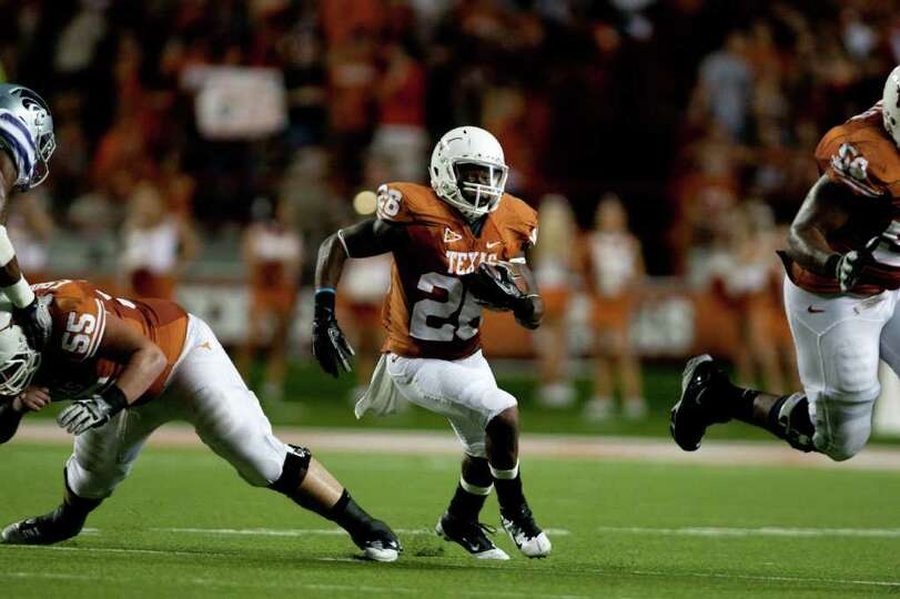 AUSTIN, TX - NOVEMBER 19:  D.J. Monroe #26 of the Texas Longhorns rushes against the Kansas State Wi