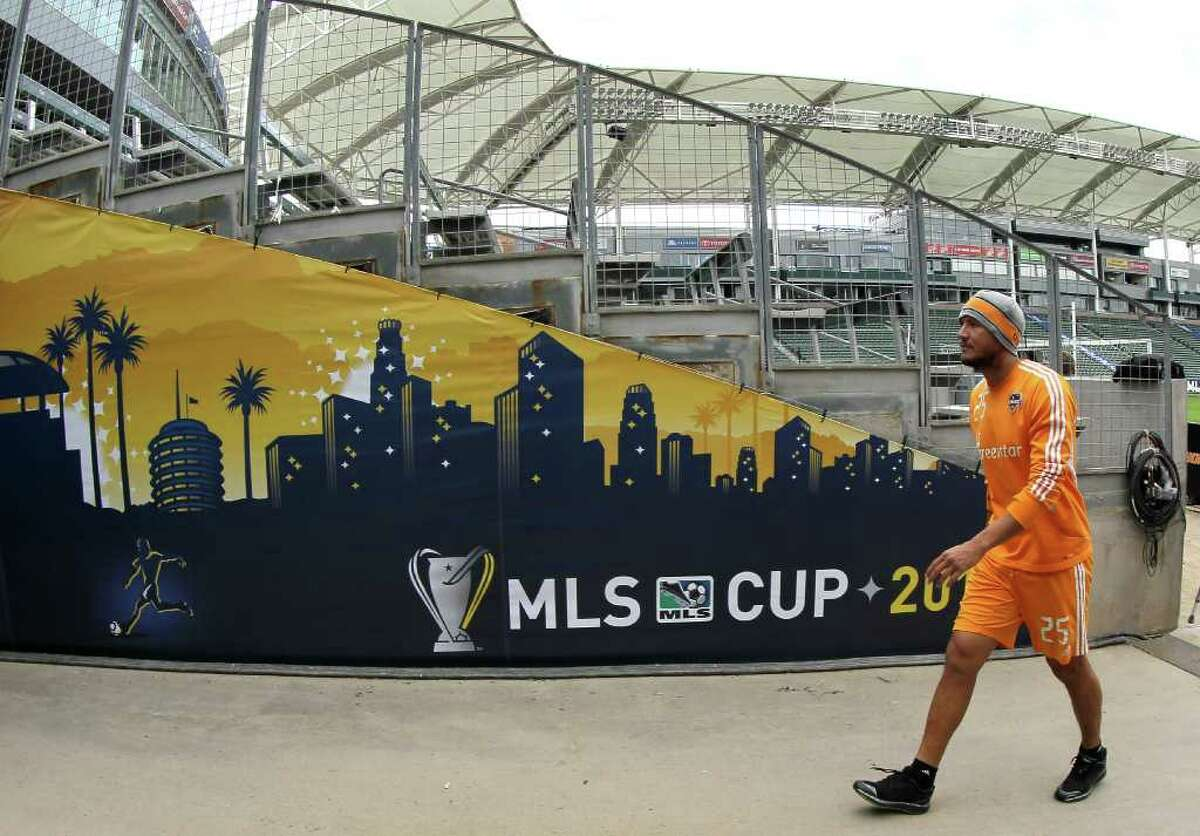 CARSON, CA - NOVEMBER 19: Brian Ching #25 of the Houston Dynamo leaves the field following a training session ahead of the MLS Cup at The Home Depot Center on November 19, 2011 in Carson, California.