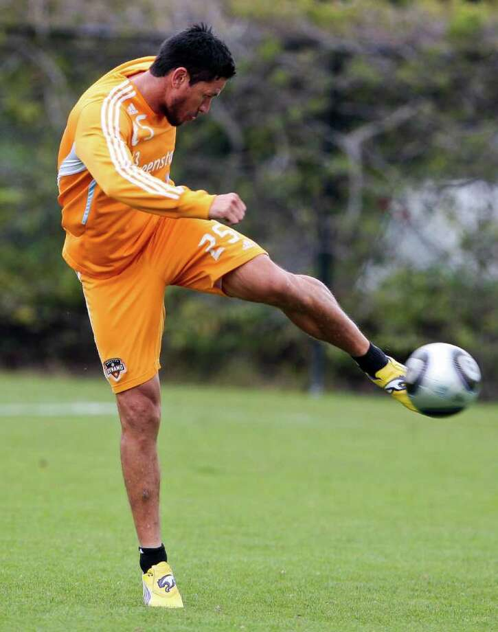 Houston Dynamo forward Brian Ching takes a shot during MLS soccer practice, Friday, Nov. 18, 2011 in Carson, Calif. The Dynamo are scheduled to play the Los Angeles Galaxy in the MLS Cup on Sunday. (AP Photo/Bret Hartman) Photo: Bret Hartman, Associated Press / FR139655 AP
