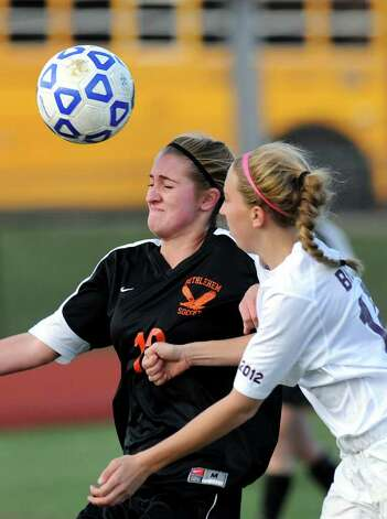 Bethlehem's Katherine Dority (12), left, hits the header as Arlington's Chelsea Brophy (18) defends during their Class AA State soccer semifinal on Saturday, Nov. 19, 2011, at Homer High in Homer, N.Y. (Cindy Schultz / Times Union) Photo: Cindy Schultz / 00015421A