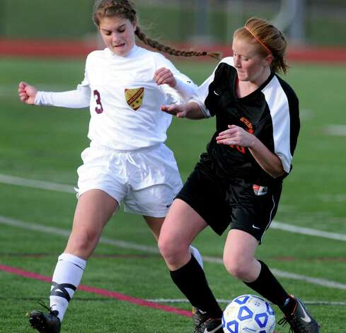 Bethlehem's Allie Olsen (16), right, controls the ball as Arlington's Shannon Palmer (3) defends during their Class AA State soccer semifinal on Saturday, Nov. 19, 2011, at Homer High in Homer, N.Y. (Cindy Schultz / Times Union) Photo: Cindy Schultz / 00015421A