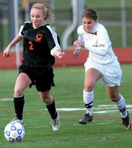 Bethlehem's Lindsey Woller (2), left, controls the ball as Arlington's Shannon Palmer (3) defends during their Class AA State soccer semifinal on Saturday, Nov. 19, 2011, at Homer High in Homer, N.Y. (Cindy Schultz / Times Union) Photo: Cindy Schultz / 00015421A