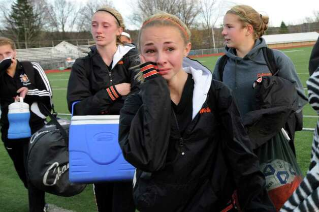 Bethlehem's Lindsey Woller (2), center, and her teammates wipe away their tears as they cross the field following their 1-0 loss to  Arlington in their Class AA State soccer semifinal on Saturday, Nov. 19, 2011, at Homer High in Homer, N.Y. (Cindy Schultz / Times Union) Photo: Cindy Schultz / 00015421A
