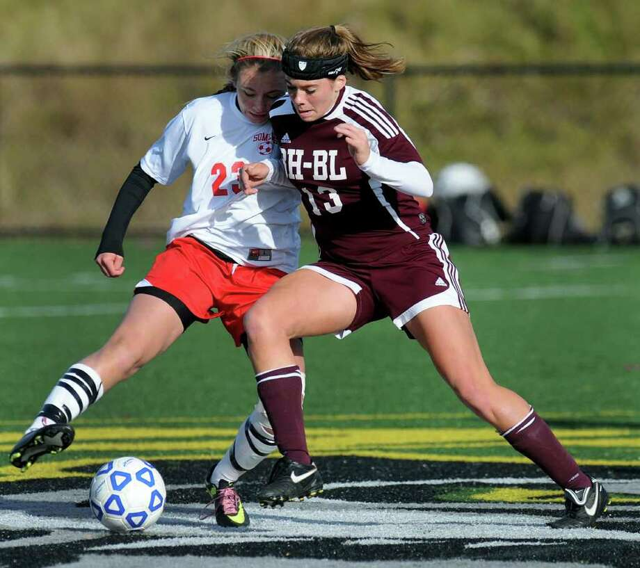Burnt Hills' Jessica Lyden (13), right, and Somers' Hayley Bonner (23) battle for the ball during their Class A State soccer semifinal on Saturday, Nov. 19, 2011, at Tompkins-Cortland Community College in Cortland, N.Y. (Cindy Schultz / Times Union) Photo: Cindy Schultz / 00015421B