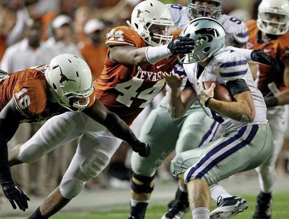 SPORTS   UT defensive end Jackson Jeffcoat brings down Kansas State quarterback Collin Klein in the fourth quarter as Texas plays Kansas State at Royal Stadium  on November 19, 2011.  Tom Reel/Staff Photo: TOM REEL, Express-News / © 2011 San Antonio Express-News